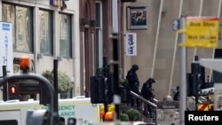 Special police forces walk at the scene of reported multiple stabbings at West George Street in Glasgow, Scotland, Britain, June 26, 2020.