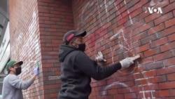 VOA英语视频: 志愿者自发清理抗议过后的城市