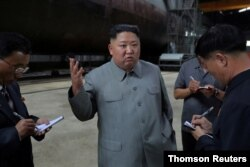 North Korean leader Kim Jong Un visits a submarine factory in an undisclosed location in North Korea, July 22, 2019.