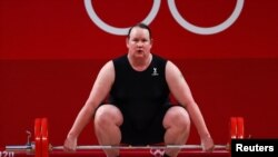 Laurel Hubbard of New Zealand competes in the women's +87kg weightlifting event at the 2020 Summer Olympics, in Tokyo, Japan, Aug. 2, 2021.