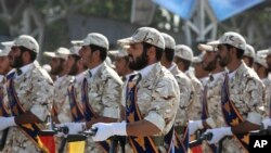 Iran's Revolutionary Guard march in front of the mausoleum of the late Iranian revolutionary founder Ayatollah Khomeini, just outside Tehran, Iran. (File)