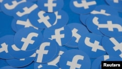 FILE - Stickers bearing the Facebook logo are pictured at Facebook Inc's F8 developers conference in San Jose, California, April 30, 2019.