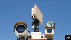 FILE - Cameras of a Border Patrol surveillance system are seen on a plateau near the U.S.-Mexico border, in Sunland Park, New Mexico, June 6, 2019.