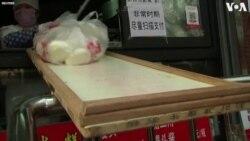 Պեկինում շոգեխաշած բլիթի խանութը վերսկսել է աշխատանքը՝ տախտակի օգնությամբ