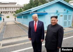 FILE - U.S. President Donald Trump meets with North Korean leader Kim Jong Un at the demilitarized zone separating the two Koreas, in Panmunjom, South Korea, June 30, 2019.