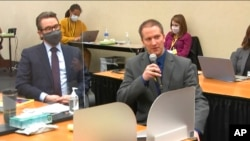 In this image from video, defense attorney Eric Nelson, left, and defendant Derek Chauvin address Hennepin County Judge PeterCahill during motions before the court, April 15, 2021, in Chauvin's trial in Minneapolis.