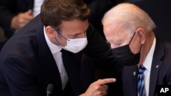 U.S. President Joe Biden, right, speaks with French President Emmanuel Macron during a plenary session during a NATO summit at NATO headquarters in Brussels, Monday, June 14, 2021. U.S. President Joe Biden is taking part in his first NATO summit,…