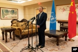 FILE - Chinese Ambassador to the United Nations Zhang Jun speaks to reporters at the Chinese Mission to the United Nations in New York, Sept. 22, 2020.