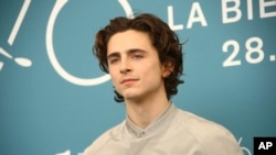 Actor Timothee Chalamet poses for photographers at the photo call for the film 'The King' at the 76th edition of the Venice Film Festival in Venice, Italy, Sept. 2, 2019.