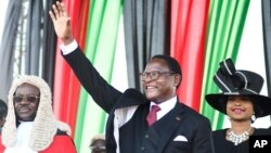 Malawi's newly elected President Lazarus Chakwera greets supporters after being sworn in in Lilongwe, Malawi, Sunday, June 28 2020. Chakwera is Malawi's sixth president after winning the historic election held last week, the first time a court…