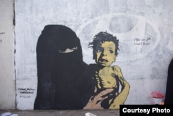 """FILE - A mural named """"A Boy of Bones,"""" painted by Yemeni artist Haifa Subay. The mural seeks to warn about the risk of famine, which is threatening the lives of millions of children in Yemen."""