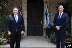 U.S. Secretary of State Mike Pompeo, left, meets Israeli Blue and White party leader Benny Gantz in Jerusalem, May 13, 2020.