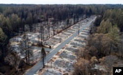 FILE - Homes were leveled by the Camp Fire line the Ridgewood Mobile Home Park retirement community in Paradise, Calif., Dec. 3, 2018.