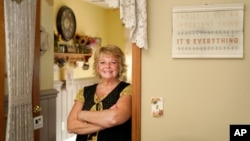 """Kay Orzechowicz poses Wednesday, Sept. 2, 2020, for a portrait at her Griffith, Ind., home. After 35 years of teaching, Orzechowicz said COVID-19 """"pushed her over the edge"""" to retire from northwest Indiana's Griffith High School at the end of July…"""