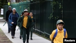 Children return to campus for the first day of New South Wales public schools fully re-opening for all students and staff amidst the easing of the coronavirus disease (COVID-19) restrictions at Homebush West Public School in Sydney, May 25, 2020.