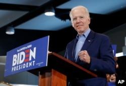 Democratic presidential candidate former Vice President Joe Biden gestures as he speaks during a caucus night event, Feb. 22, 2020, in Las Vegas.