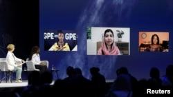 Malala Yousafzai, joining by video link, speaks লন্ডনে বিশ্ব শিক্ষা সম্মেলনে ভাষণদানরত নোবেল শান্তি পুরস্কার বিজয়িনী, পাকিস্তানের মালালা ইউসুফজাই, ২৯শে জুলাই, ২০২১-রয়টার্স