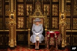 FILE - Britain's Queen Elizabeth II delivers a speech in the House of Lords during the State Opening of Parliament, at the Palace of Westminster in London, May 11, 2021.