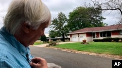 FILE - Democratic organizer Bill Chandler reviews a voter contact sheet while canvassing, Sept. 21, 2019, in Whitewater, Wis. Democrats hope to win back Wisconsin by rebuilding the infrastructure they let crumble ahead of the last presidential election.