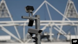 FILE - A security cctv camera is seen by the Olympic Stadium at the Olympic Park in London.