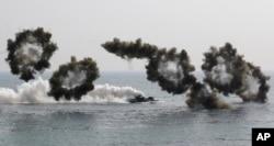 FILE - South Korean amphibious assault vehicles participate in a 2015 U.S.-South Korea joint military exercise.