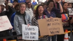 Congressional Democrats Tell Trump to End Travel Ban