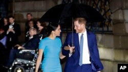 FILE - Britain's Prince Harry and Meghan arrive at the annual Endeavour Fund Awards in London, March 5, 2020. The Duke and Duchess of Sussex are expecting their second child, their office confirmed Sunday, Feb. 14, 2021.