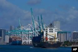 FILE - The Warnow-Dolphin container ship enters PortMiami, in Miami Beach, Fla., April 29, 2021.