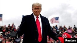 U.S. President Donald Trump arrives for a campaign rally at Oakland County International Airport in Waterford Township, Michigan, Oct. 30, 2020.