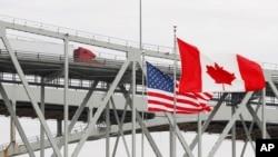 A truck crosses the Blue Water Bridge into Port Huron, Mich., from Sarnia, Ontario, Canada, March 18, 2020.