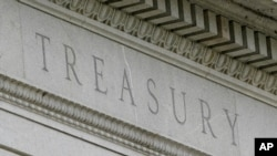 FILE - This May 4, 2021 file photo shows the Treasury Building in Washington.