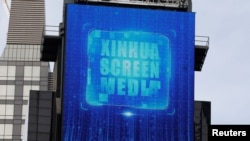 A screen advertising Xinhua News Agency is seen in Times Square in the Manhattan borough of New York City, New York, U.S., March 2, 2020. (REUTERS/Andrew Kelly)