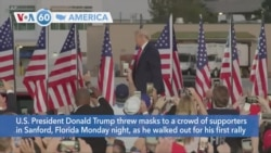 VOA60 Ameerikaa - President Trump threw masks to supporters at his first rally since he contracted the coronavirus