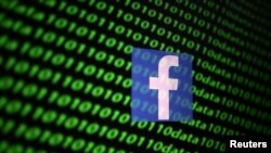 二进制数字代码上的脸书标志。(2019年11月26日)