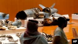 FILE - The Saudi military displays what they say are an Iranian cruise missile and drones used in recent attacks on its oil industry, during a press conference in Riyadh, Saudi Arabia, Sept. 18, 2019.