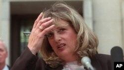 Linda Tripp, the Pentagon employee whose secret tape recordings of former White House intern Monica Lewinsky triggered a criminal investigation of President Clinton, talks to reporters in Washington, July 29, 1998.