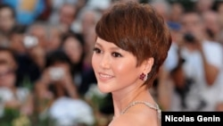 FILE - Chinese singer and actress Tan Weiwei at the Venice Film Festival, Sept. 12, 2009.