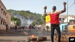 In this photo taken Friday, June 19, 2020, protesters demanding President Ibrahim Boubacar Keita's resignation take to the streets in the capital Bamako, Mali.