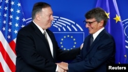 U.S. Secretary of State Mike Pompeo shakes hands with European Parliament President David Sassoli at the EU Parliament in Brussels, Belgium, Sept. 3, 2019.