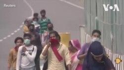 印度当局为外来务工人员安排返乡火车和巴士