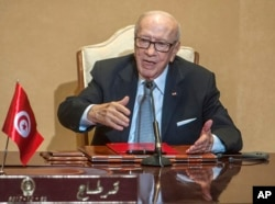 FILE - Tunisian President Beji Caid Essebsi gestures during a press conference in Tunis, Oct. 25, 2018.