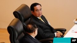 Thailand's Prime Minister Prayuth Chan-ocha, top, talks to Deputy Prime Minister Prawit Wongsuwan during the special session at the parliament in Bangkok, Thailand, Monday, Oct. 26, 2020. Thailand's Parliament began a special session Monday that was…