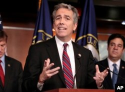 FILE - Former U.S. Rep. Joe Walsh, R-Ill., gestures during a news conference on Capitol Hill in Washington.