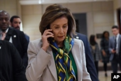 House Speaker Nancy Pelosi of Calif., walks on Capitol Hill in Washington, March 12, 2020, as she heads to a briefing on the coronavirus.