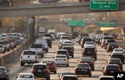 FILE - Traffic flows on the Hollywood Freeway in Los Angeles, Dec. 12, 2018.