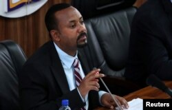 FILE - Ethiopia's Prime Minister Abiy Ahmed speaks during a session of Parliament in Addis Ababa, Oct. 22, 2019.