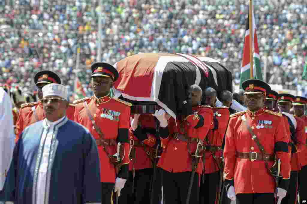 Kenyan military pallbearers carry the casket of former president Daniel arap Moi, draped in a Kenyan flag, at his state funeral in Nyayo Stadium, in Nairobi.