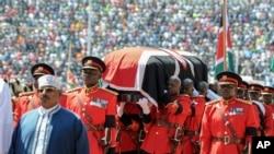 Kenyan military pallbearers carry the casket of former president Daniel arap Moi, draped in a Kenyan flag, at his state funeral in Nyayo Stadium, in Kenya's capital of Nairobi, Kenya, Feb. 11, 2020.