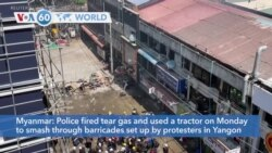 VOA60 Addunyaa - Myanmar: Police fire tear gas and use a tractor to smash through barricades set up by protesters