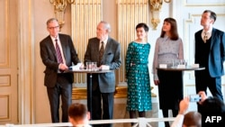 Members of the Nobel Committee for Literature (L-R) Chairman Anders Olsson, Per Wastberg, Rebecka Karde, Mikaela Blomqvist and Henrik Petersen announce the winners of the 2018 and 2019 Nobel Prize in Literature at the Swedish Academy in Stockholm,…